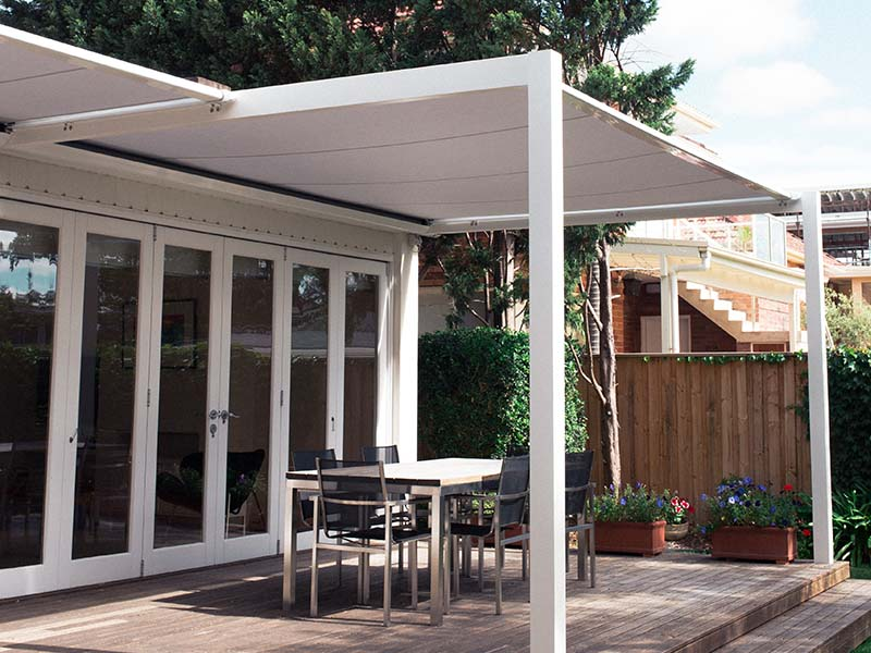 Patio awning on white timber frame for outdoor dining area