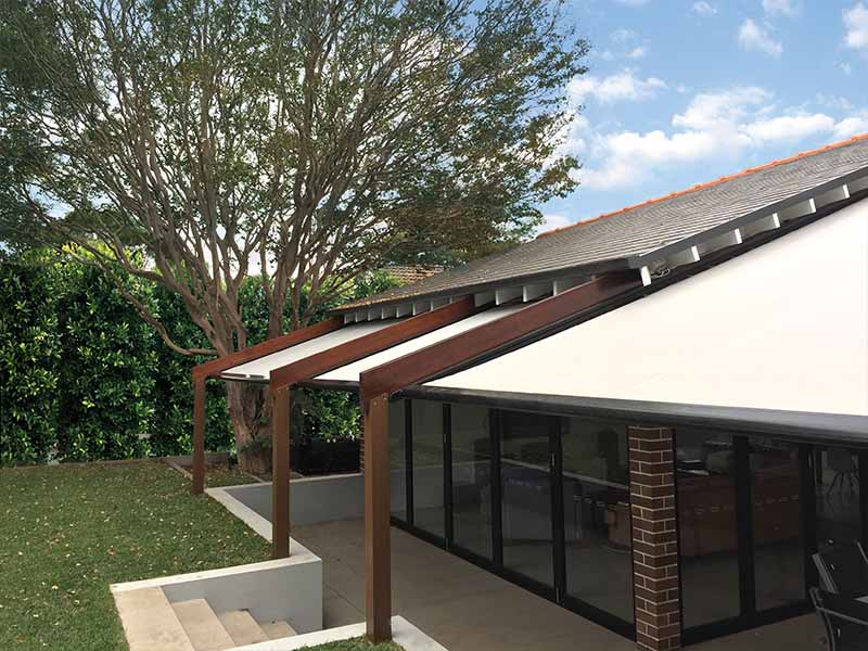 Patio retractable awning on custom made pergola frame for sun and rain protection
