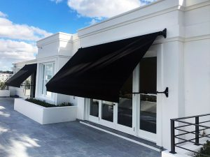 Federation style retractable drop arm awning for a stylish traditional look