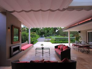 Retractable Roof Awning creates an outdoor living area