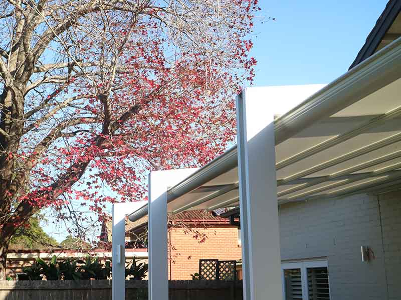 Retractble awning on pergola frame for sun and rain protection