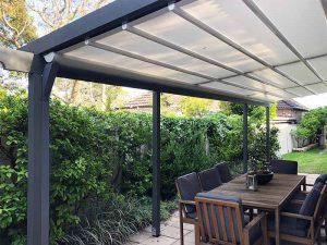 custom designed timber pergola frame with weather proof awning