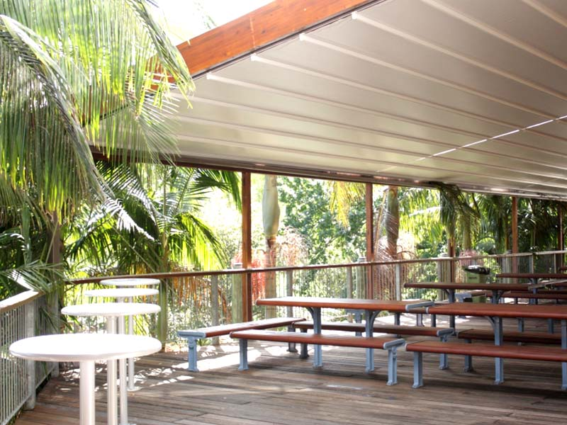 Retractable awning over deck for all weather protection