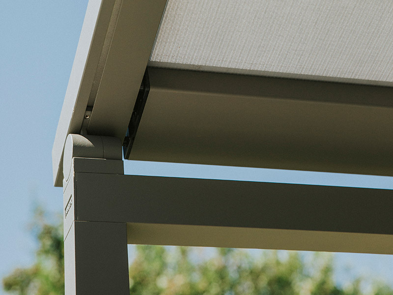 Detail of posts and runners of zip patio awning