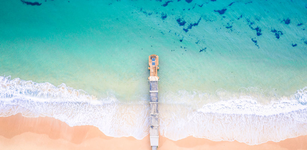 Collaroy storm water pipe amidst a electric blue ocean. Aalta supplies retractable awnings to the Collaroy Area and the Northern Beaches.