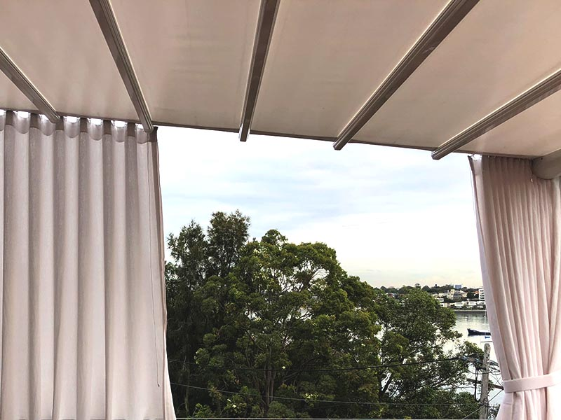 Outdoor curtains with retractable roof over deck