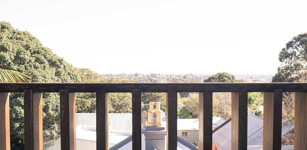 The view from a roof top apartment in Chippendale, A suburb Sydneys Inner West. Taken from the West facing balcony where Aalta Australia had recently installed a retractable awning. The afternoon lights sets over a view of the city.