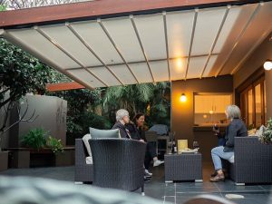dine outside under a retractable awning in Manly