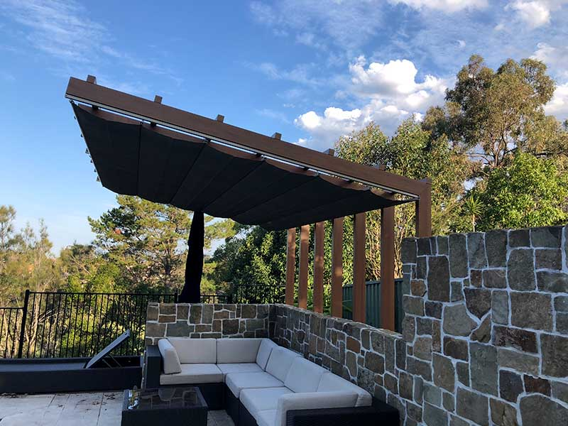 Retractable Shade Sail over comfy lounge