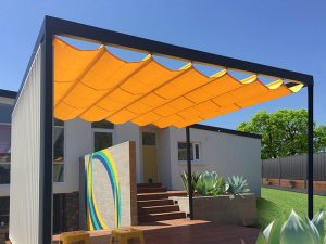Bright Yellow retractable shade sail over free stading cabana