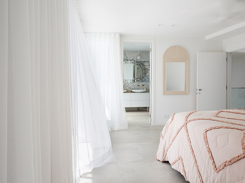 Sheer curtains in bedroom add a touch of romance and give privacy