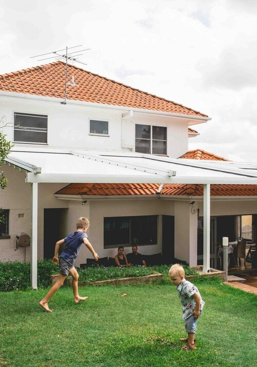 retractable roof extended over outdoor area with children playing outside