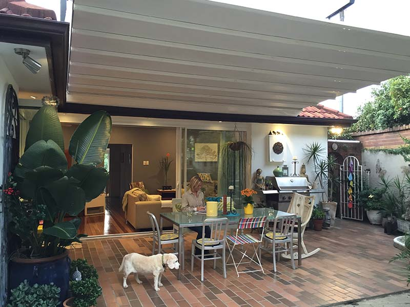 Outdoor living space with a retractable roof