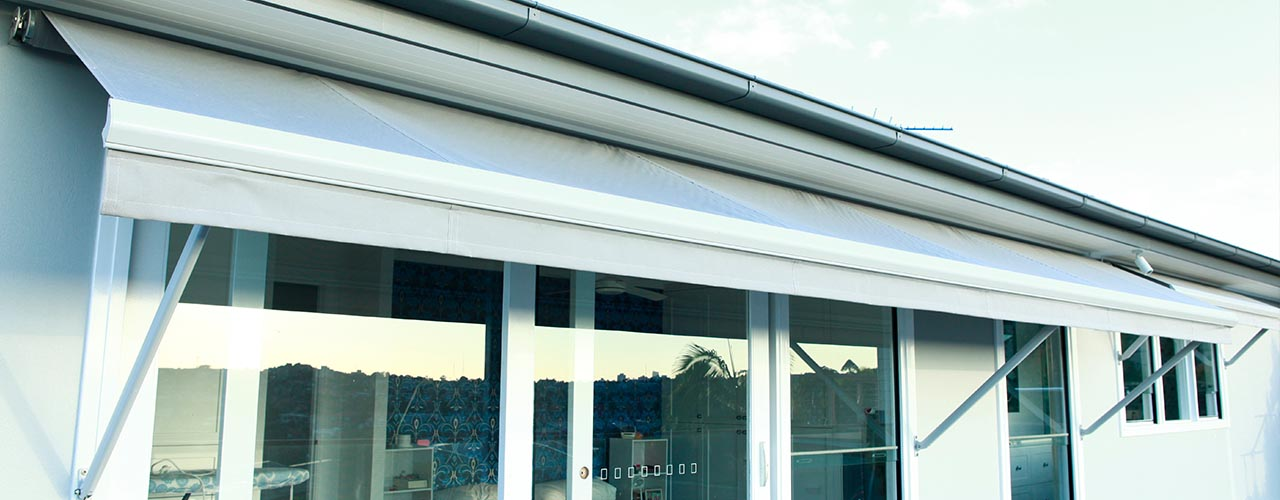motorised drop arm awning giving relief from the sun and privacy