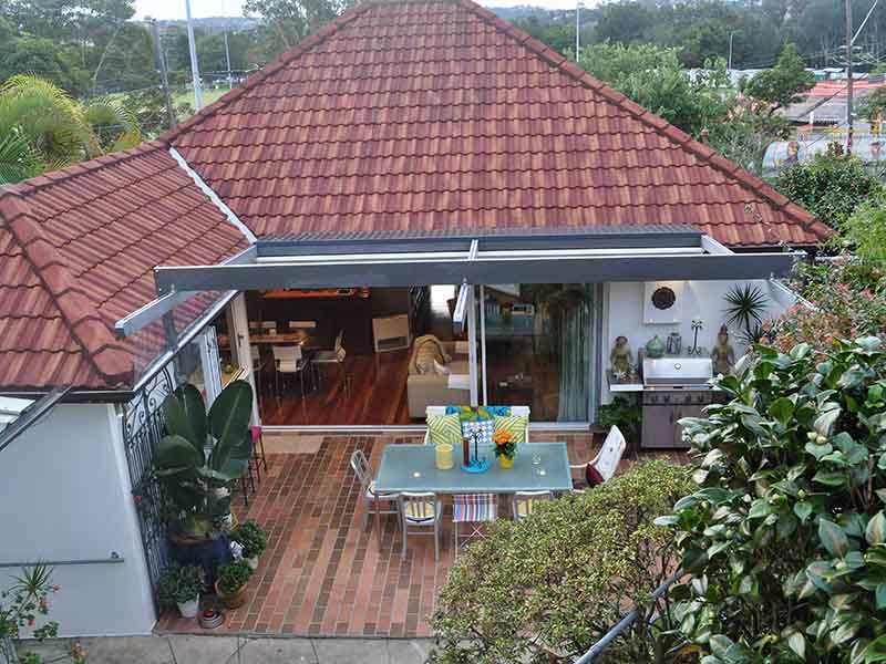 Retractable roof over homes outdoor living space
