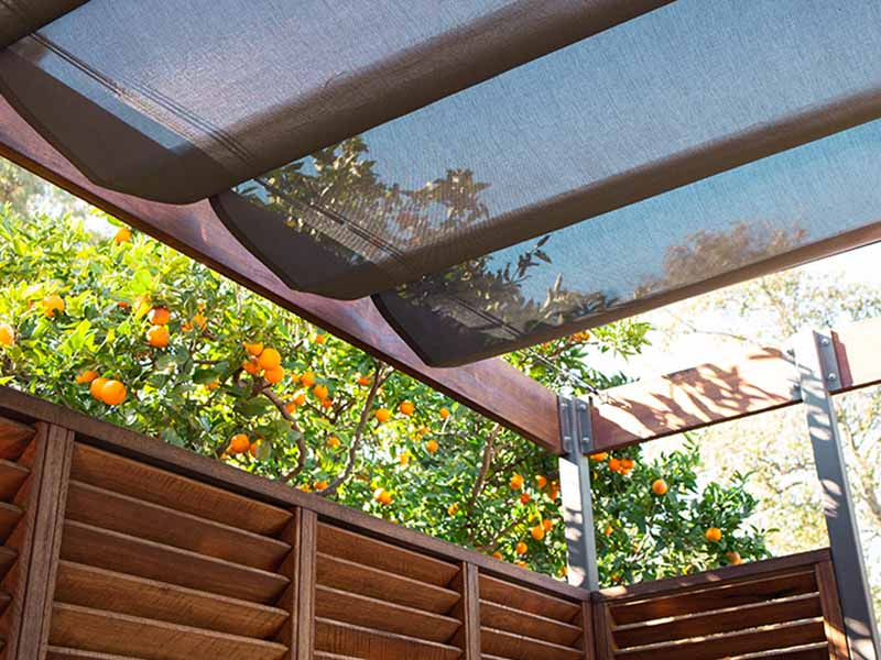 Retractable shade sail over deck