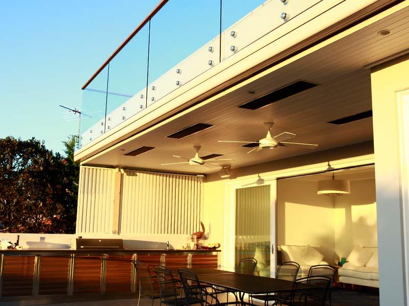 Modern heaters over outdoor courtyard