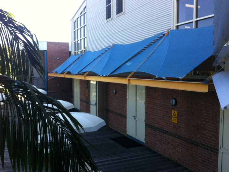 Outside courtyard in school before a retractable roof