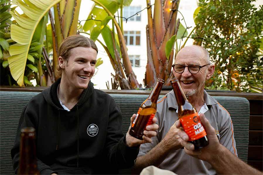 Patrons at Old Mates Place Rooftop Bar enjoying a beer